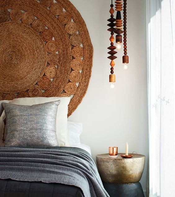 a new oversized jute rug like this one can be used as a headboard for a nature-inspired or Asian-inspired space