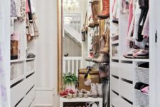 21 a small vintage-inspired sweet closet with a large mirror, a crystal chandelier, open shelves and holders plus drawers