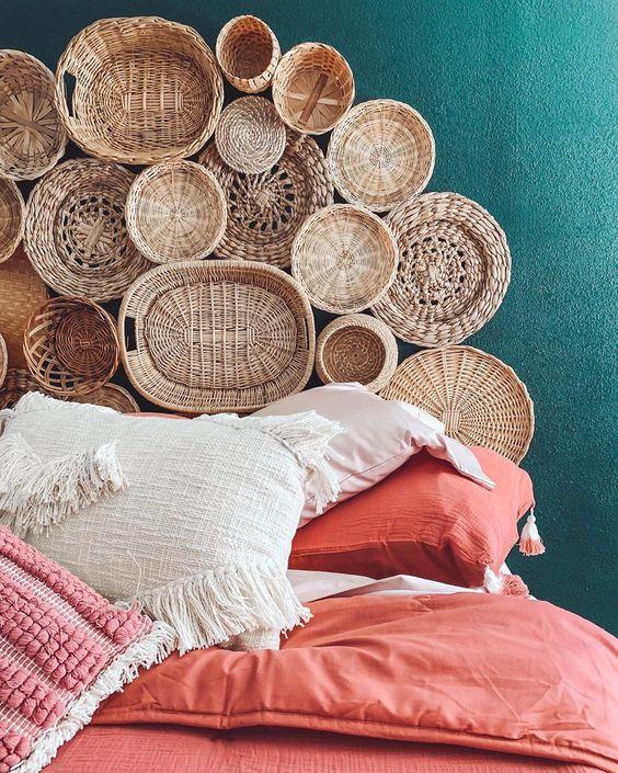 a stack of decorative baskets attached to the wall will make your bedroom feel more rustic and more natural