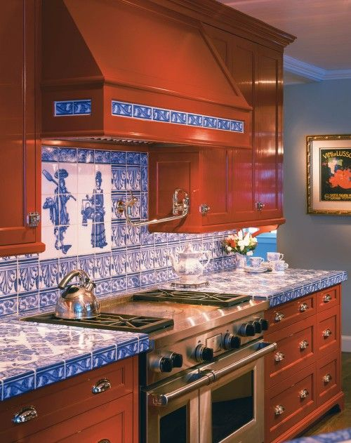 a rich-stained kitchen of wood accented with blue tile countertops and a matching backsplash to make it bold