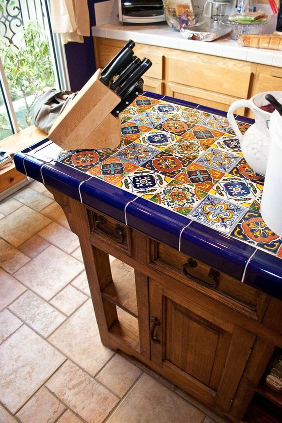 a vintage-inspired wooden kitchen with a bright tile countertop that makes it outstanding and really bold and cool