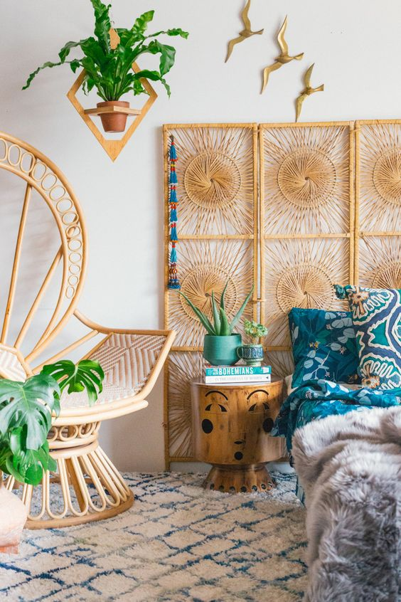 a woven screen instead of a headboard and a peacock chair will make your bedroom feel trendy and boho