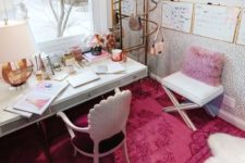 a bold glam home office with a lavender pillow, a hot pink rug, some pink accessories and touches