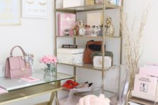 a chic home office with pink books and accessories, with a pink knot pillow and bag and touches of gold