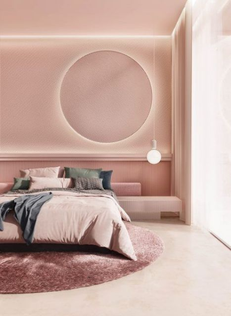 a chic modern bedroom with pink walls and a ceiling, with a round lit up mirror, a bulb, muted color bedding and a pink round rug