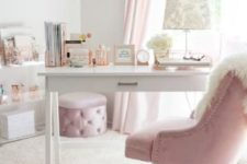 a glam home office in white and light pink, with pink curtains, a glam ottoman and a chair plus elegant prints