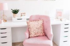 a glam home office with pink tropical artworks, a pink chair with a sequin pillow and other touches of pink