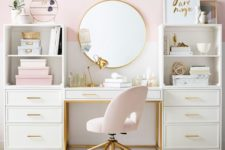 a stylish glam home office with a pink color block wlal, pink accessories and a chair and touches of gold