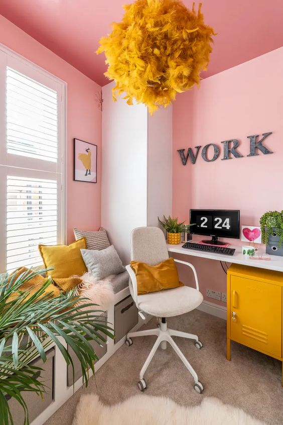 a super bold home office in pink, grey and mustard, with pink walls and a ceiling, with mustard accessories is a unique space