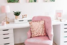 a tropical-inspired home office with a pink chair, a pink gallery wall and some more accessories in this amazing color