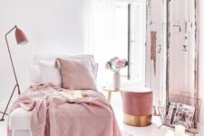 a welcoming white bedroom with a pink ottoman, pink and white bedding, a pink lamp and magazine stand is wow