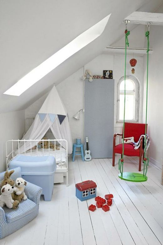 a white attic nursery with colorful furniture and toys, with a swing is very fun and veyr welcoming