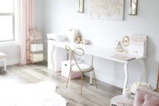 an airy and ethereal home office with white walls, pink curtains, pink furniture and some accessories plus a crystal chandelier