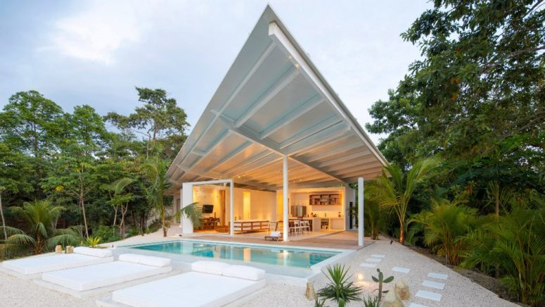 This contemporary villa is built in a remote part of Costa Rica and features all white and an angular roof