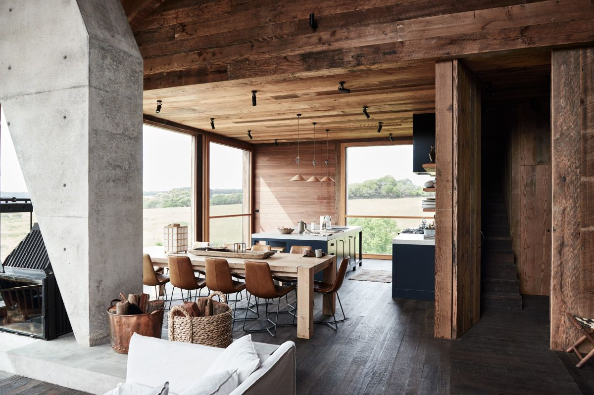 This gorgeous wooden cabin is built in the middle of nature, it features modern rustic design and stunning views