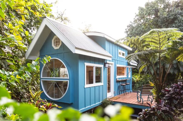 This lovely blue home is just 260 square feet and it features cool decor and much character