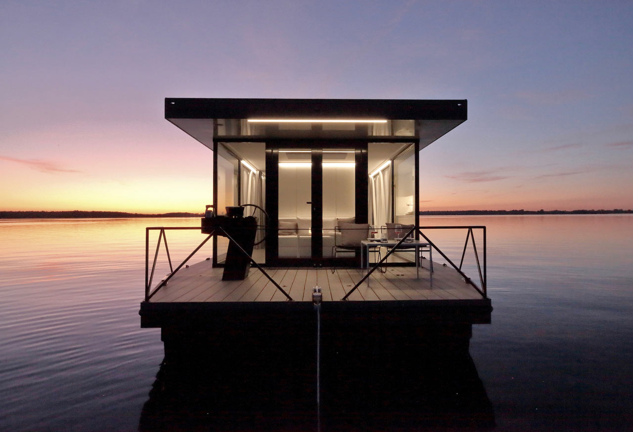 This small apartment on the water is called loungeboat and is a real boat home that is comfortable and stylish