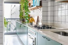 02 The kitchen is long and narrow, done with green cabinets, white terrazzo countertops, blush and white tile backsplashes