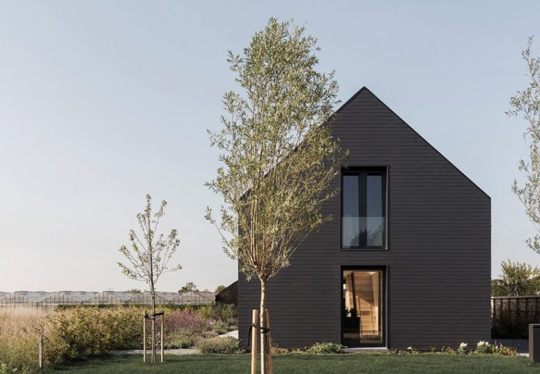 The traditional barn shape of the house is complemented with lots of glazing and bold black exterior