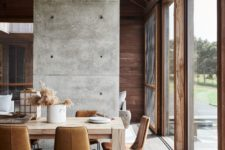02 There's much natural wood in various stains in decor and it's complemented with concrete and leather for an ultra-modern look