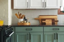 02 a trendy two-tone kitchen with upper white cabinets and lower chalk painted ones looks very chic