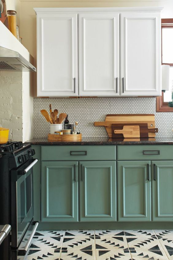a trendy two-tone kitchen with upper white cabinets and lower chalk painted ones looks very chic