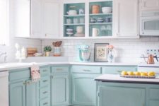 03 a two-tone kitchen with white uppers and light blue lowers plus gold hardware looks cool