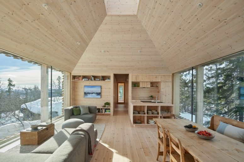 The interiors are clad with wood, the furniture is also made of wood to make it fele all-natural and welcoming
