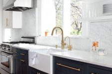 04 a black kitchen with white stone countertops and a backsplash looks very contrasting