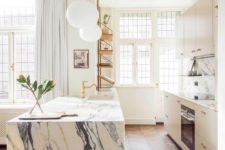 04 a chic modern kitchen in white and a white marble kitchen island, gold fixtures for a more glam look