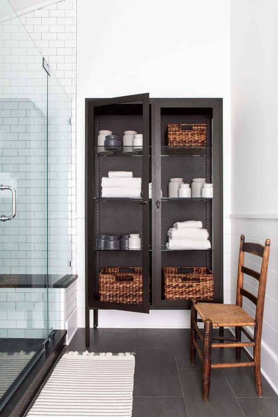a glass closet with towels is a nice towel storage piece but it fits only a large bathroom