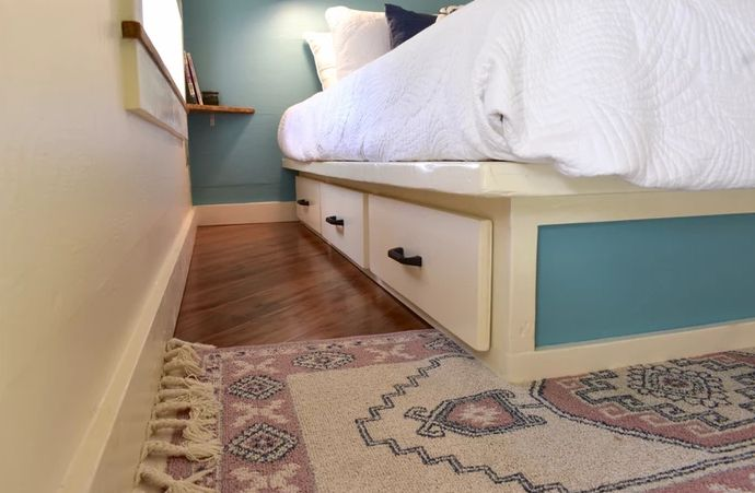 The bed features some storage drawers
