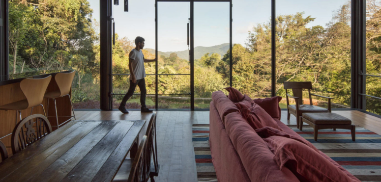 The indoors is fully opened to outdoors, there are glazed walls to enjoy the views of the rainforest