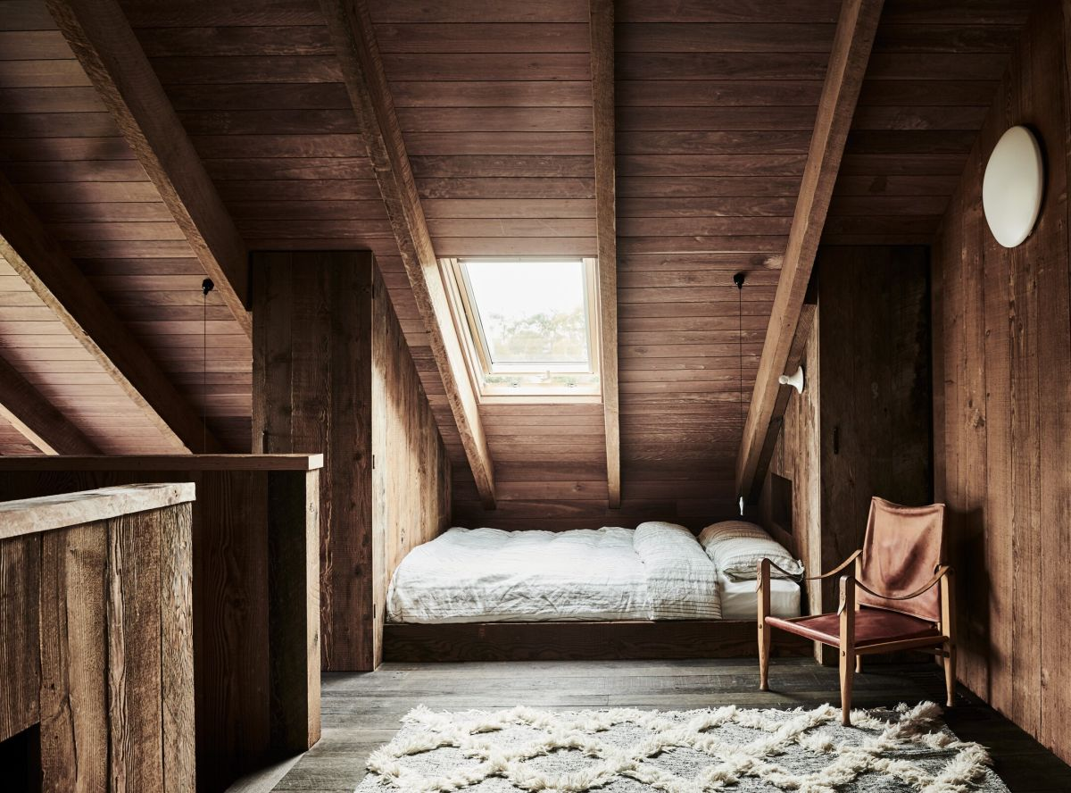 The upstairs bedroom area has a very cozy attic like feeling due to the slanted ceiling