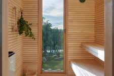 05 There's a sauna that features a glazed entrance to enjoy the views while staying here