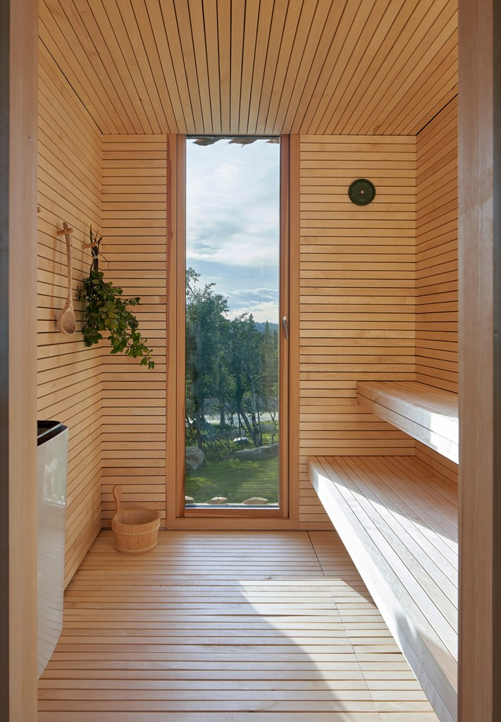 There's a sauna that features a glazed entrance to enjoy the views while staying here