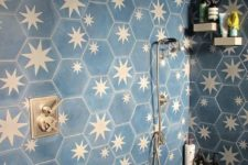 05 a chic bathroom clad with navy and brass star tiles looks very bold and very dreamy with these celestial tiles
