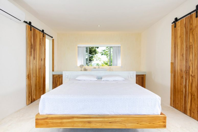 The bedroom are decotated all-neutral, with a floating bed and a vanity table