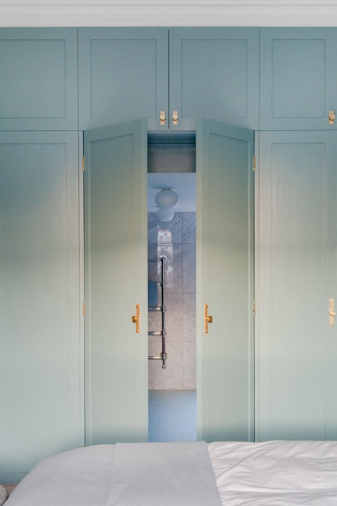 The master bathroom is hidden behind a set of the doors