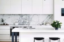 06 a chic white minimalist kitchen with touches of black for more drama and a white marble backsplash for a refined feel