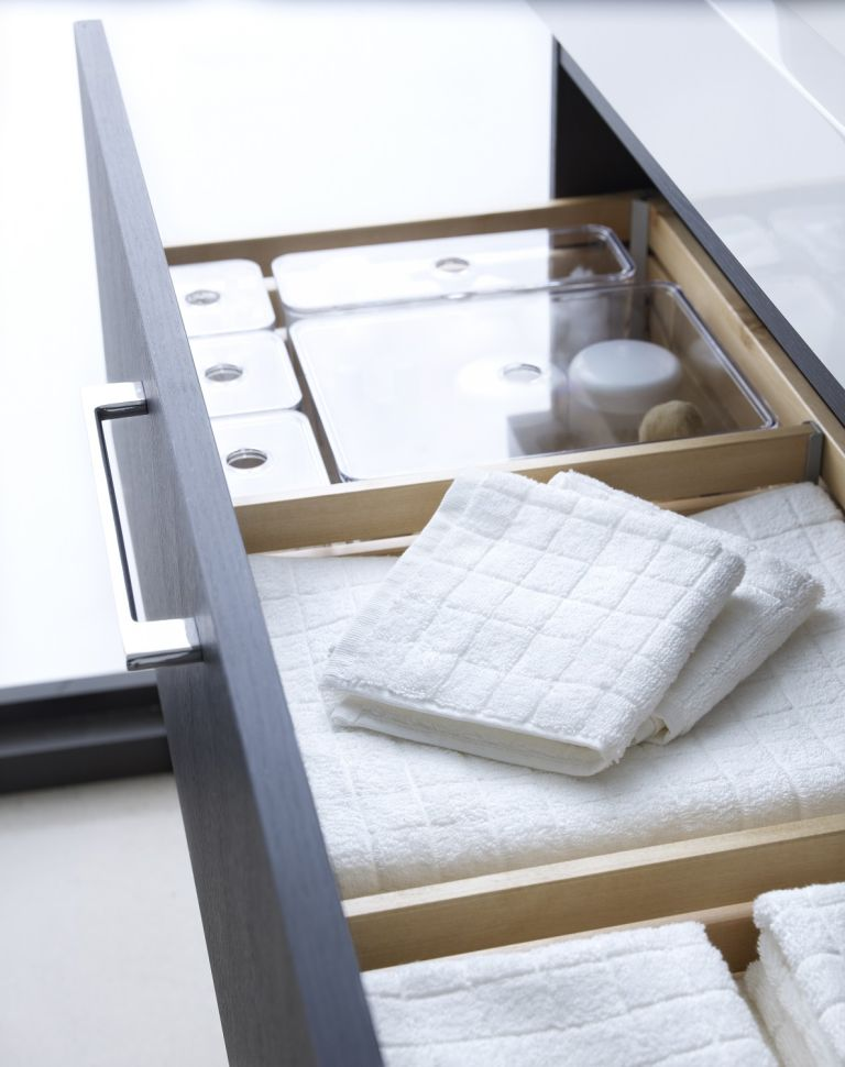a drawer in the vanity will save much space and hold everything you need, from towels to makeup