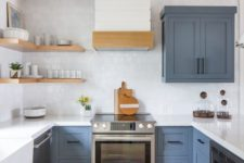 06 an elegant kitchen with classic blue cabinets, white tiles and countertops plus open shelves