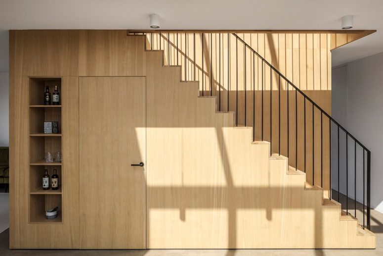 The staircase is a cool pantry and open storage unit, it's very functional, which is a great solution to steal