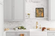 07 a dove grey farmhouse kitchen with white stone countertops and a white marble backsplash for more elegance