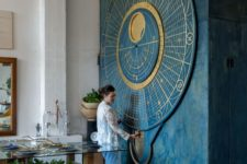 07 a gorgeous oversized moon calendar themed wall art in blue and gold is a bold statement