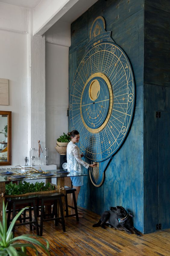 a gorgeous oversized moon calendar themed wall art in blue and gold is a bold statement
