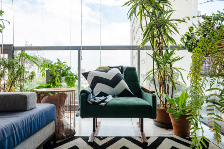 Lots of potted greenery brings a natural feel to the space, and it creates an outdoor feeling