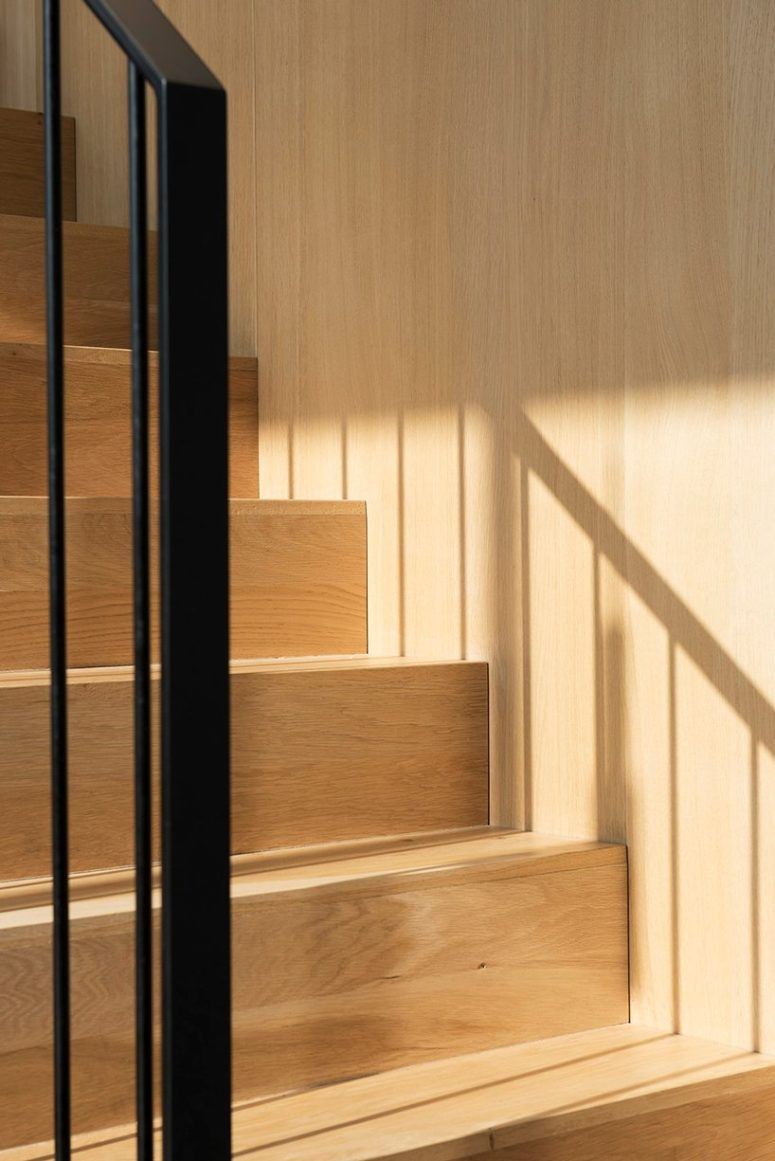 Much wood and plywood is used inside to make the minimalist spaces more welcoming and cozy