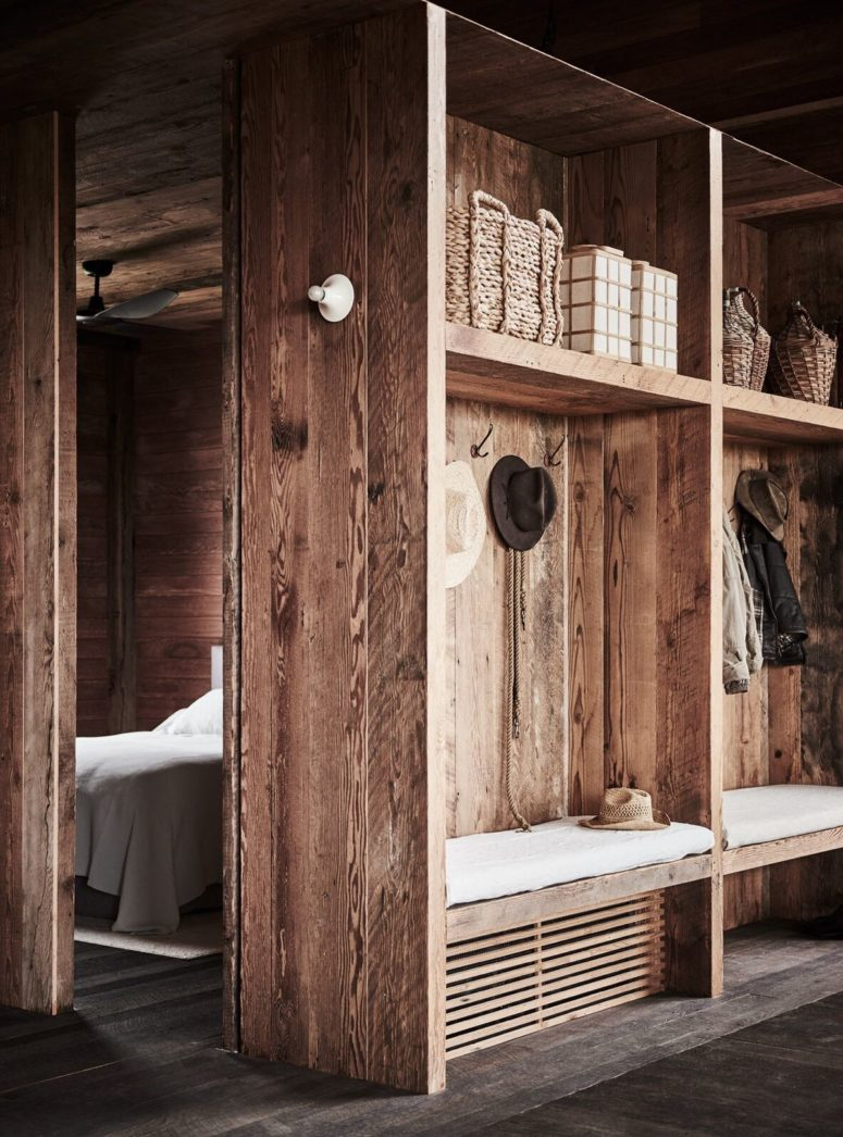 The entryway is simple and very rustic, fully done in natural wood