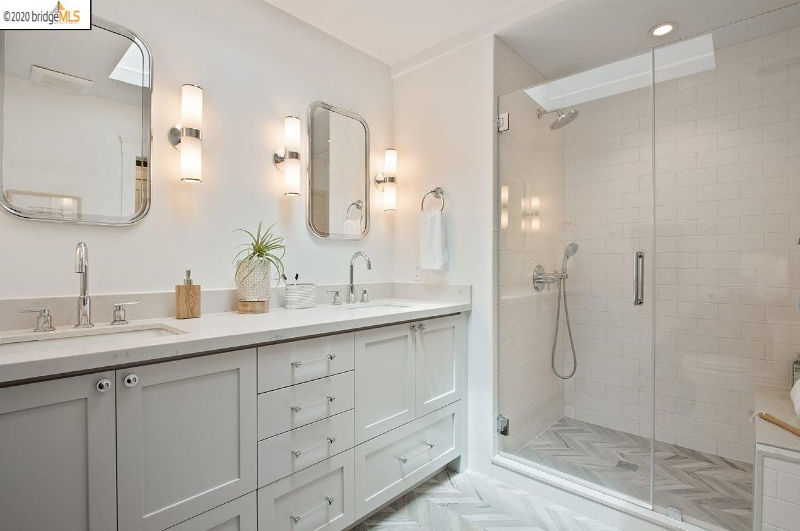 The master bathroom is done in neutrals, a double vanity and a shower space